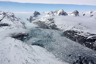 Fjord - A glacier in eastern Greenland flowing through a fjord carved by the movement of ice
