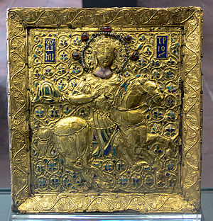 Byzantine army (Komnenian era) - Gold icon of St Demetrios as a cavalryman. The saint is armoured in an epilōrikion-covered klivanion with splint armour for the upper arms and a splint kremasmata. The detailing at the ankle may indicate that podopsella greaves are being depicted.  Note the overtly straight-legged riding posture (with the heel lower than the toes) indicative of the adoption of Western-style lance techniques. Byzantine, 12th century