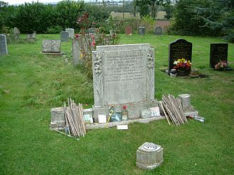 John Bonham - John Bonham's gravestone at Rushock Parish churchyard, Worcestershire, with drumsticks left in tribute by fans