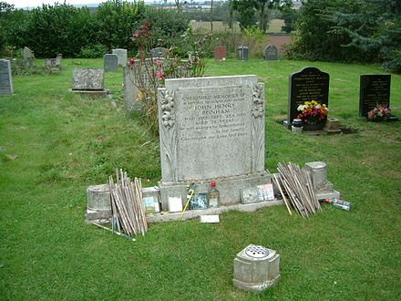 John Bonham's gravestone at Rushock Parish churchyard, Worcestershire, with drumsticks left in tribute by fans Grave JohnBonham sept07.JPG