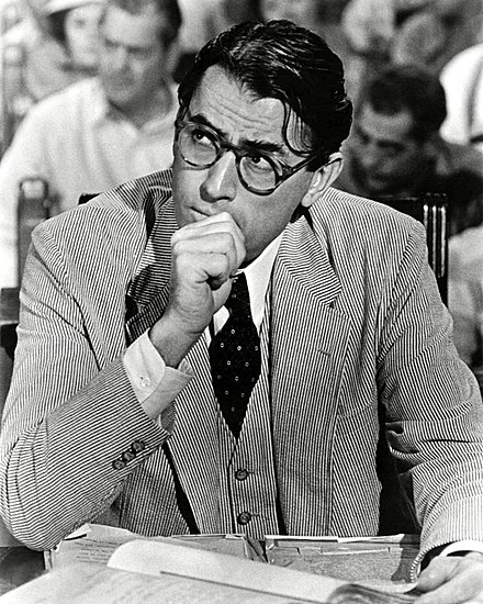 Peck as Atticus Finch in To Kill a Mockingbird (1962) Gregory Peck Atticus Publicity Photo.jpg
