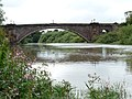 Grosvenor Bridge, Chester - view of east side from south bank of River Dee north of River Lane.jpg