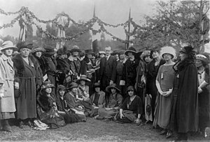 Pan-American Conference of Women - Group at the International Tree Planting, with women from 21 nations who are attending the Pan-American Conference of Women. in the center of the group are Antoinette Carter Hughes, wife of the US Secretary of State, Grace Coolidge and Vice President Calvin Coolidge.