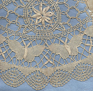 Guipure Type of bobbin lace in which motifs are connected by bars or plaits