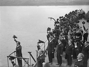 HMS Phoebe (43) - The Commanding Officer leading the cheers for HM King George VI, on board Phoebe, part of the Home Fleet at Scapa Flow in 1943