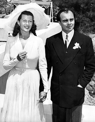 Prince Aly Khan - Rita Hayworth and Aly Khan at their wedding reception in the garden of the Château de l'Horizon, near Cannes (27 May 1949)
