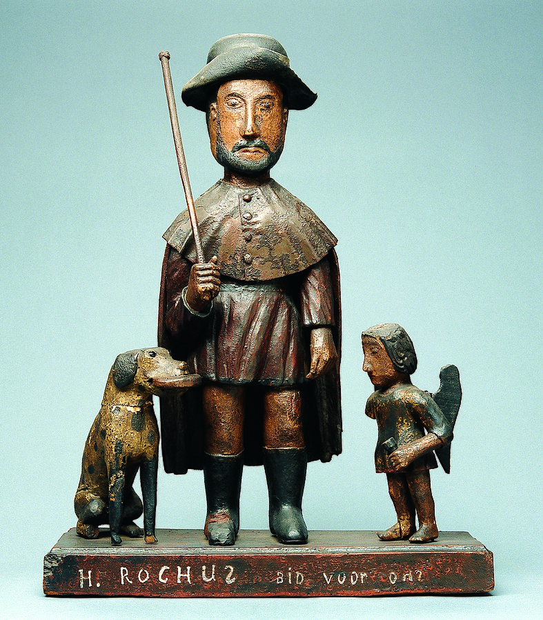 Devotional statue of Saint Roch with a dog and an angel