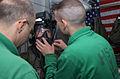 Helicopter Anti-submarine FOUR's (HS 4) Aviation Anit-submarine Warfare Operator Second Class (AW-NIC) Jarad Gilbertson of Cedar Ridges, I.W. recieves help from Survival Equipmentman Second Class Coale Lindsay 030323-N-AK921-029.jpg