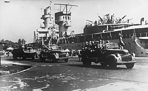 Military history of the Netherlands during World War II - KNIL units passing light cruiser De Ruyter in Soerabaja, c. 1940