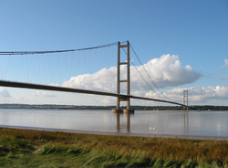 A long suspension bridge over a large expanse of water