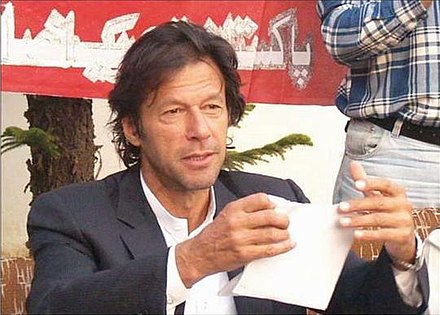 Khan tearing his nomination paper for National Assembly at a press conference; he boycotted the 2008 elections. Iktearsoffpapers.jpg