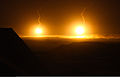 Illumination rounds light up the night sky, fired by U.S. Marines with the 2nd Combat Engineer Battalion (CEB), around the Ladar bazaar to pinpoint enemy positions in Shukvani, Helmand province, Afghanistan 110806-M-VI276-087.jpg