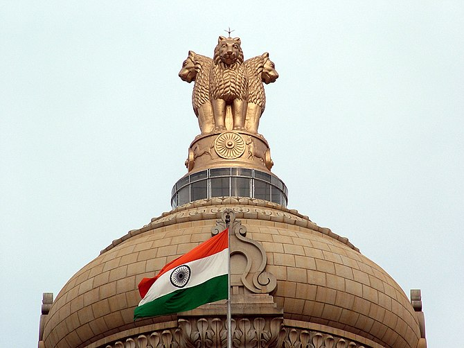 Indian flag and the State Emblem atop Vidhana ...