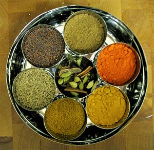Spice - A group of Indian spices and herbs in bowls
