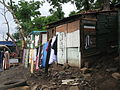 Informal settlement where people now have community ablution blocks (8152040443).jpg