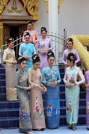 Traditional Thai clothing - Thai women wearing Isan Modifide sinh dress for Prapheni Bun Bang Fai in Roi Et
