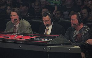 "Michael Cole (wrestling) - Cole (center) commentating on Raw with John ""Bradshaw"" Layfield (left) and Jerry Lawler (right) in January 2014"