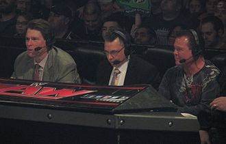 "Sports commentator - Professional wrestling commentators John ""Bradshaw"" Layfield, Michael Cole, and Jerry ""The King"" Lawler."