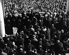 a79621f1adf The Inauguration of John F. Kennedy as seen from behind. The few top hats in  the crowd can be distinguished by the shininess of the hat s flat crown