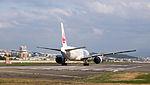 Japan Airlines Boeing 777-246ER JA708J Taking off from Taipei Songshan Airport Runway 20150102.jpg
