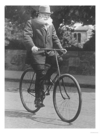 Tire - John Boyd Dunlop on a bicycle c. 1915