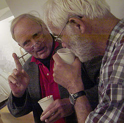 John Clauser conversing with Mike Nauenberg.jpg