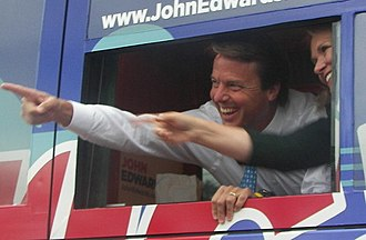 2008 Democratic Party presidential debates and forums - John Edwards and wife Elizabeth greet supporters while arriving to the debate in his campaign bus