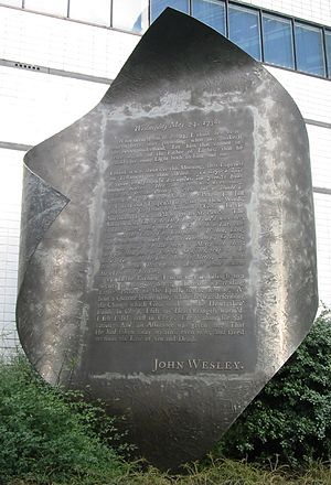 Sola scriptura - In the Wesleyan Quadrilateral, experience is an additional source of authority. Pictured is a memorial to John Wesley's own experience of the New Birth and Assurance.