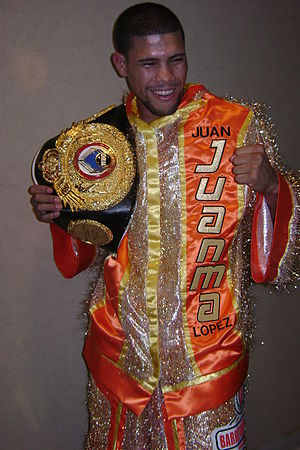 Championship belt - Juan Manuel López with the WBO Latino Super Bantamweight championship belt