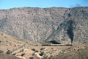 Khyber train safari - The Khyber Railway. With a Pakistan Railways HGS 2-8-0 at front and rear a charter train climbs the Khyber Pass through a series of zig-zags to gain height.
