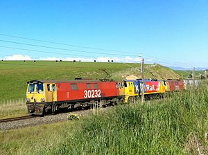 New Zealand EF class locomotive - Three EF locomotives on a freight train north of Feilding. The first locomotive is in the International Orange livery.