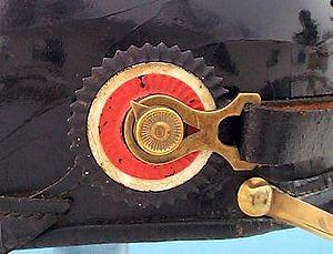 Cockade - A metal cockade on the swivel of a Pickelhaube helmet.