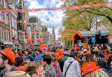 Dutch people in orange celebrating King's Day in Amsterdam, 2017 Koningsdag 2017 Amstel.jpg