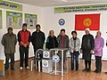 Kyrgyz Election Volunteers Pose for a Photo (5123488076).jpg