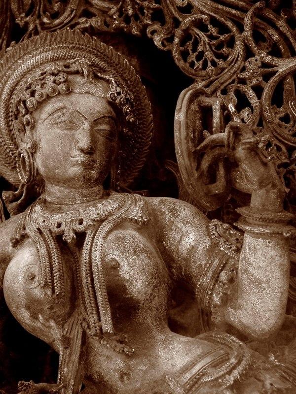 Lady looking into mirror Belur Halebidu
