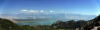 Tourism in Albania - A panoramic view of Lake Shkodër and the Albanian Alps in the distance.