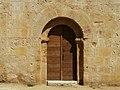 Lalinde Ste Colombe église portail ouest.jpg