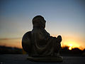 Laughing Buddha Facing Sunset (4894213963).jpg