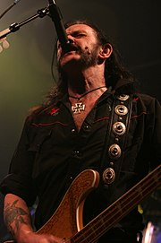 Lemmy in his usual singing stance, with his microphone in its high position.