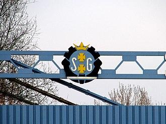 Coat of arms of Gdańsk - Image: Logo of Gdańsk Shipyard at entry near Solidarności Square 2