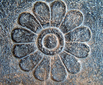 Reliefs of lotus flowers are frequently used on the walls and monuments at Persepolis. Lotus Achaemenid architecture.JPG