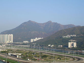 Ma On Shan (peak) - Overlooking Sha Tin Racecourse, Ma On Shan and its saddle is unmistakable