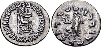 "Maues - Coin of Machene, Queen of Maues. Obv. Tyche, wearing mural crown. Legend BACIΛICCHC ΘEOTPOΠOY MAXHNHC ""Godlike Queen Machene"". Rev. Zeus with Nike, legend ""Rajatirajasa mahatasa Moasa"" in Kharoshthi ""Great king of kings, Maues""."