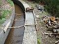 Madeira-Reparatur einer Levada.jpg