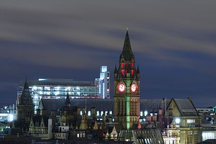 View across the rooftops by night, from the North-west Manchester Town Hall by night from Renaissance Hotel.JPG