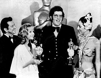 Marvin Hamlisch - Hamlisch, at age 29, holding two of the three Oscars he won in 1974. With him are Donald O'Connor, Debbie Reynolds and Cher.