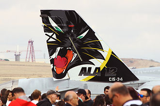 """Ala 12 - Tail of a EF-18A of Ala 12 with the famous cat  for the motto of the wing """"No le busques los tres pies al gato"""" """"Don't look for the cat's three feet"""" in English, a famous proverb in Spanish which has as its origin in the novel of Don Quixote de la Mancha."""