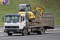 Mercedes-Benz truck in Belarus with an excavator.jpg