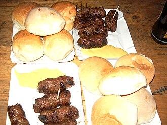 Romanian cuisine - Mititei, mustard, and bread rolls