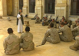 Chaplain - A Catholic chaplain ministers to American Marines and Sailors in Tikrit, Iraq